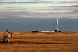 An oil drilling rig on the Bakken formation in Watford City, North Dakota. The Bakken stretches from South Dakota into Canada's province of Saskatchewan.