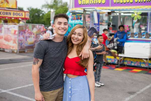 San Antonians flocked to the Fiesta Carnival following Friday's Battle of Flowers Parade April 27, 2018.