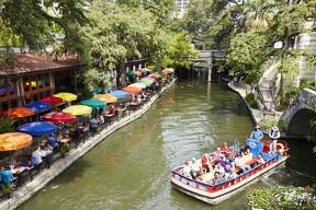 People enjoying the River Walk, San Antonio, USA. (Photo by: Loop Images/UIG via Getty Images)