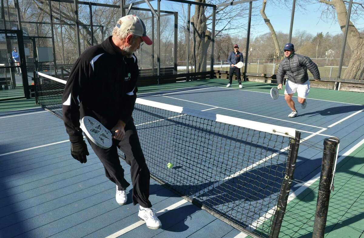 Andy Timmerman gets the shot while playing with Chris Pilder against BJ Parey and Rob Ackerman during a game with the Rowayton Paddle Tennis Association on Sunday March 11, 2018 at The Rowayton Library paddle tennis courts in Norwalk Conn.