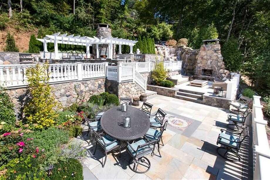 The outdoor patio and kitcken constructed on a lakeside New Fairfield home by celebrity chef Donatella Arpaia that officials with Firstlight say was built illegally. The state Supreme Court on Friday upheld previous decisions that most of the structures should be removed. Photo: / Contributed