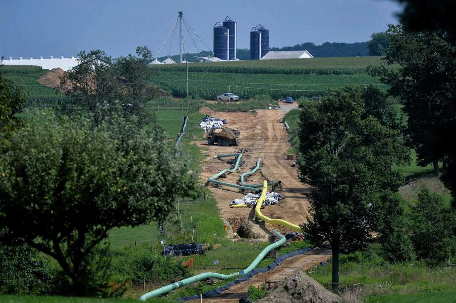 Sections of pipe sit near a farm at an Energy Transfer Partners construction site for the Sunoco Mariner East 2 natural gas liquids pipeline project near Morgantown, Pennsylvania, on Aug. 4, 2017. Energy Transfer is among at least seven pipeline operators reporting in April that their electronic communications systems were shut down, with five confirming the service disruptions were caused by hacking. Photo: Charles Mostoller/Bloomberg / Bloomberg