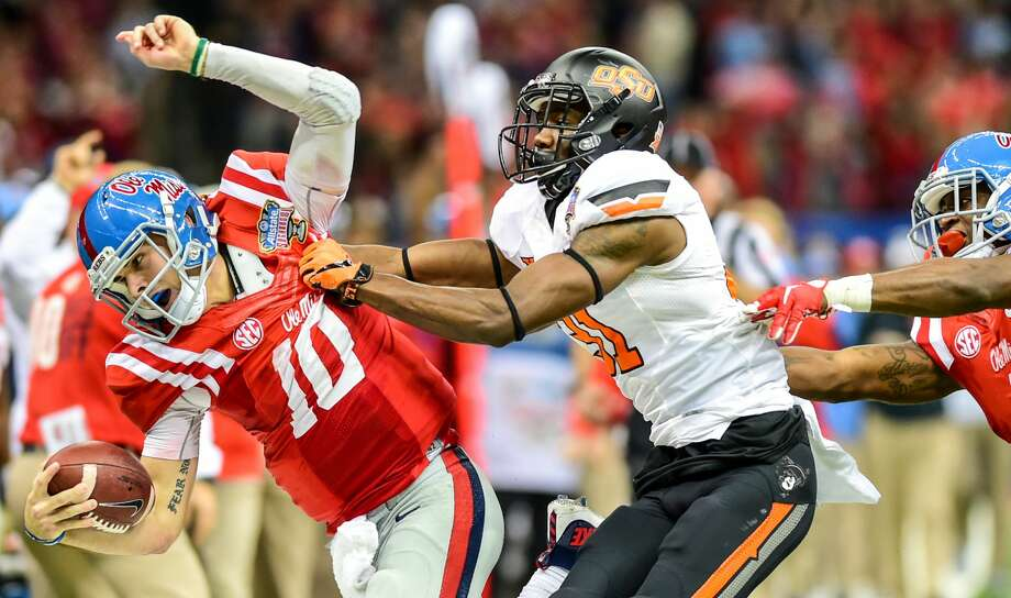January 01, 2016: OK State Cowboys safety Tre Flowers (31) puts a big hit on Ole Miss Rebels quarterback Chad Kelly (10) sending him out of bounds during the 2016 Allstate Sugar Bowl featuring the Oklahoma State Cowboys vs Ole Miss Rebels at the Mercedes-Benz Superdome, New Orleans, Louisiana. (Photo by Ken Murray/Icon Sportswire) (Photo by Ken Murray/Icon Sportswire/Corbis via Getty Images) Photo: Icon Sports Wire/Corbis Via Getty Images
