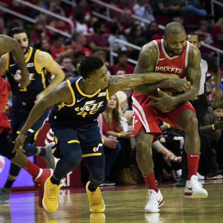 Utah Jazz guard Donovan Mitchell (45) battles for the ball against Houston Rockets forward PJ Tucker, right, (4) and Houston Rockets center Nene Hilario (42) during the second half of the game on Sunday, Nov. 5, 2017, at the Toyota Center in Houston. The Rockets won against the Utah Jazz 137-110. ( Marie D. De Jesus / Houston Chronicle ) Photo: Marie D. De Jesus, Staff / Houston Chronicle / © 2017 Houston Chronicle
