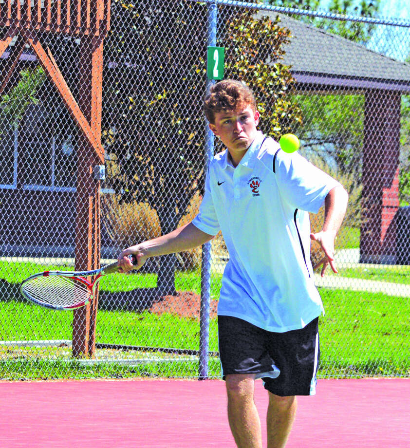 Edwardsville junior Nick Hobin makes a forehand return during his No. 1 singles match on Saturday in the Tiger Duals at the EHS Tennis Center