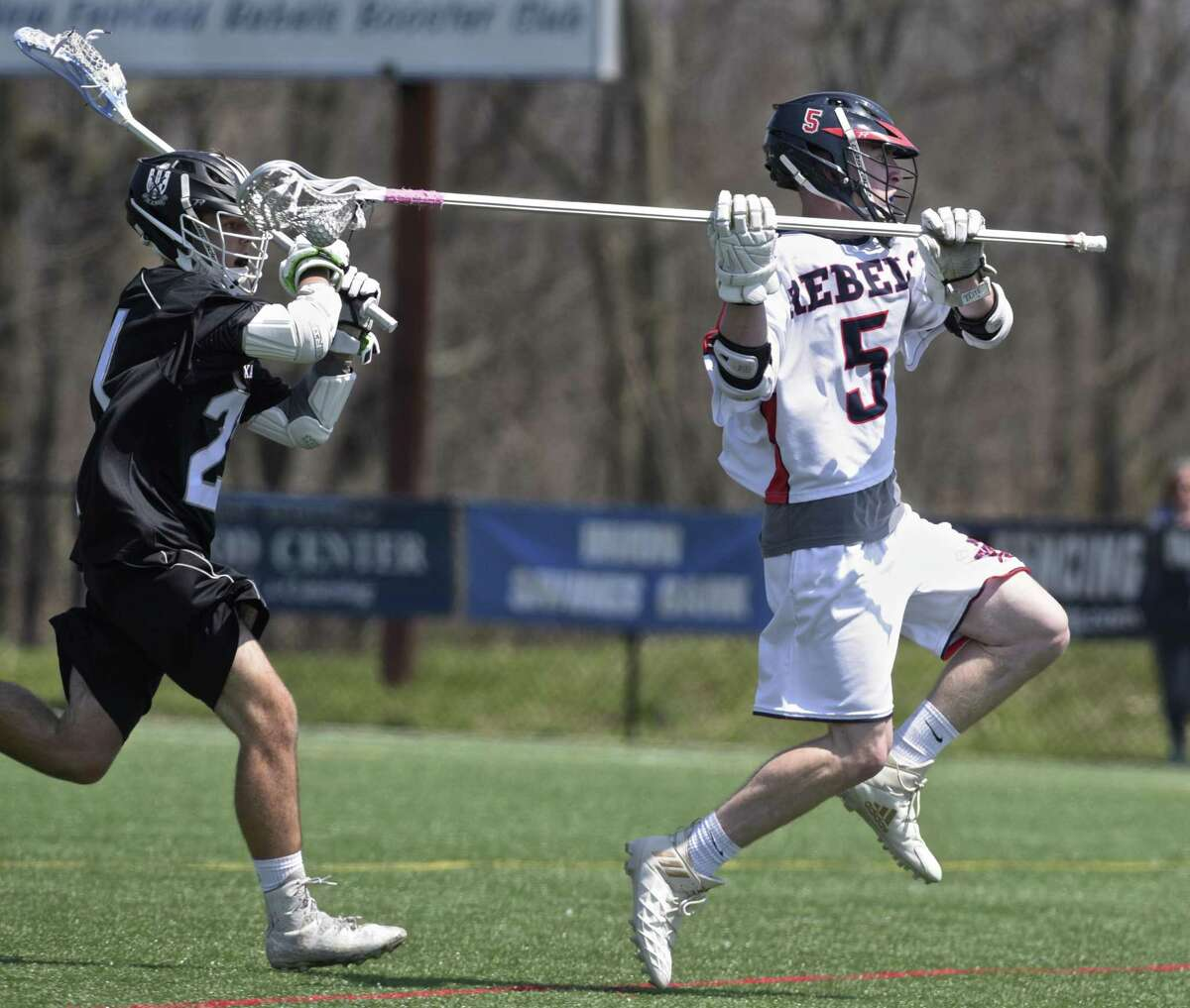 New Fairfield's William Enright gets set to take a shot in front of Xavier's Erik Fellenstein during the Rebels' 16-5 victory on Saturday in New Fairfield.