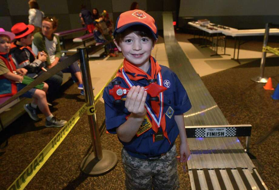 Cub Scout with Pack 55 in Darien Theo Buchesky won first place in hi division during The Powahay districts Pinewood Derby Championship and fun Mystery at the Museum event Saturday, April 28, 2018, at Stepping Stones Children's Museum in Norwalk, Conn. The top District Pinewood Derby winners will compete in the ConnJam Council Championship. Top winners at ConnJam will attend the Pinewood Derby World Championship Times Square NY Photo: Erik Trautmann / Hearst Connecticut Media / Norwalk Hour