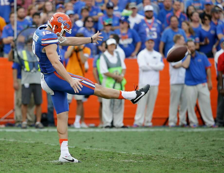 Florida punter Johnny Townsend kicks against Tennessee during the second half of an NCAA college football game, in Gainesville, Fla. Florida kicker Eddy Pineiro and punter Johnny Townsend are looking to become the first specialists drafted from the same team in the same year since 1985. Photo: John Raoux / Associated Press