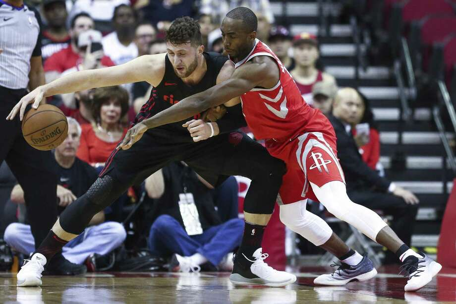 Houston Rockets forward Luc Mbah a Moute (12) leans in to guard Portland Trail Blazers center Jusuf Nurkic (27) as the Houston Rockets take on the Portland Trail Blazers at the Toyota Center Thursday, April 5, 2018 in Houston. (Michael Ciaglo / Houston Chronicle) Photo: Michael Ciaglo, Houston Chronicle / Houston Chronicle / Michael Ciaglo