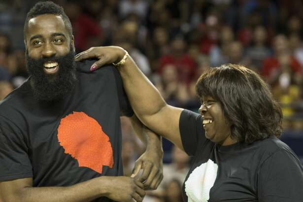 Houston Rockets star James Harden and his mother Monja Willis share a joyful moment while Houston Mayor Sylvester Turner is presenting Harden a James Harden Day certificate during Harden's charity basketball tournament at Rice University's Tudor Field House Sunday, Aug. 20, 2017, in Houston. The James Harden-led Big Tony defeated John Wall-led La Flame 103-102. ( Yi-Chin Lee / Houston Chronicle )