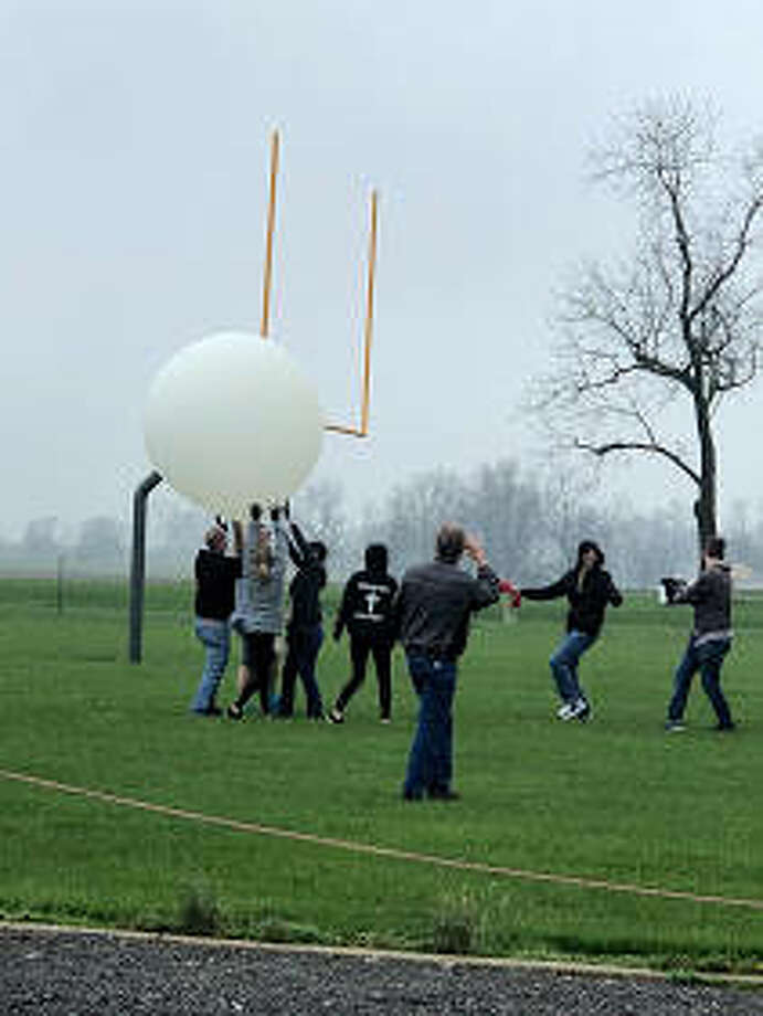 Students in Jeremiah Goltz's physics class at Bunker Hill High School send off a weather balloon Tuesday that soared to 70,000 feet. Submitted art by John King.