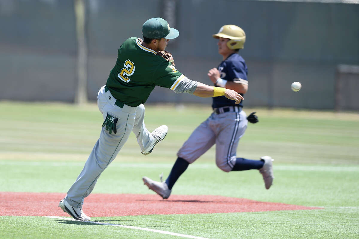 Midland College's Frainyer Chavez (2) throws for an out at first base past a Frank Phillips College baserunner, finishing the inning April 28, 2018, at Christensen Stadium. James Durbin/Reporter-Telegram