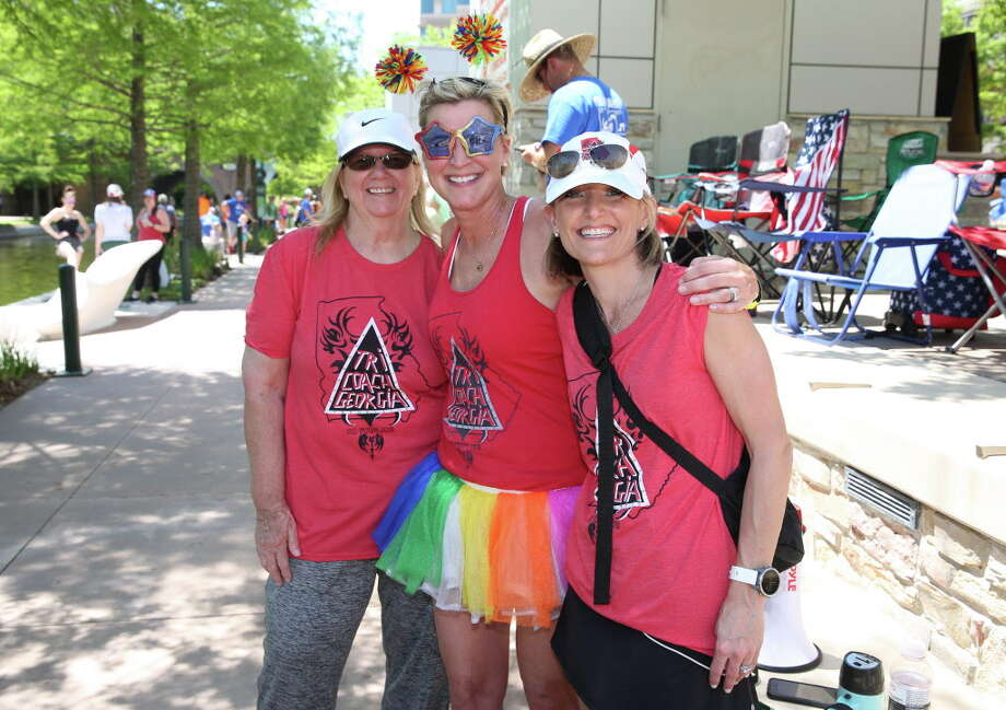 Supporters pose for a photograph at the 2018 Memorial Hermann IRONMAN® North American Championship Texas Triathlon on The Woodlands Waterway on Saturday, April 28, 2018, in The Woodlands. The IRONMAN features 2.4 miles of swimming, 112 miles of biking and 26.2 miles of running. Photo: Yi-Chin Lee, Houston Chronicle / © 2018 Houston Chronicle