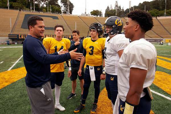 1of4california Quarterback Coach Marques Tuiasosopo Left Talks To His Qbs Following The Spring Football Scrimmage At Memorial Stadium Saay April 28
