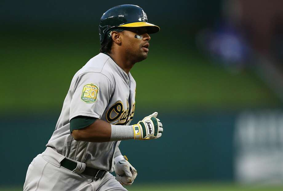 ARLINGTON, TX - APRIL 25:  Khris Davis #2 of the Oakland Athletics runs the bases after hitting a two-run homerun in the third inning against the Texas Rangers at Globe Life Park in Arlington on April 25, 2018 in Arlington, Texas.  (Photo by Ronald Martinez/Getty Images) Photo: Ronald Martinez / Getty Images