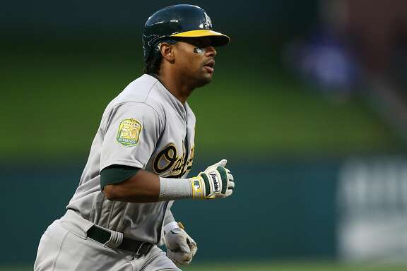ARLINGTON, TX - APRIL 25:  Khris Davis #2 of the Oakland Athletics runs the bases after hitting a two-run homerun in the third inning against the Texas Rangers at Globe Life Park in Arlington on April 25, 2018 in Arlington, Texas.  (Photo by Ronald Martinez/Getty Images)