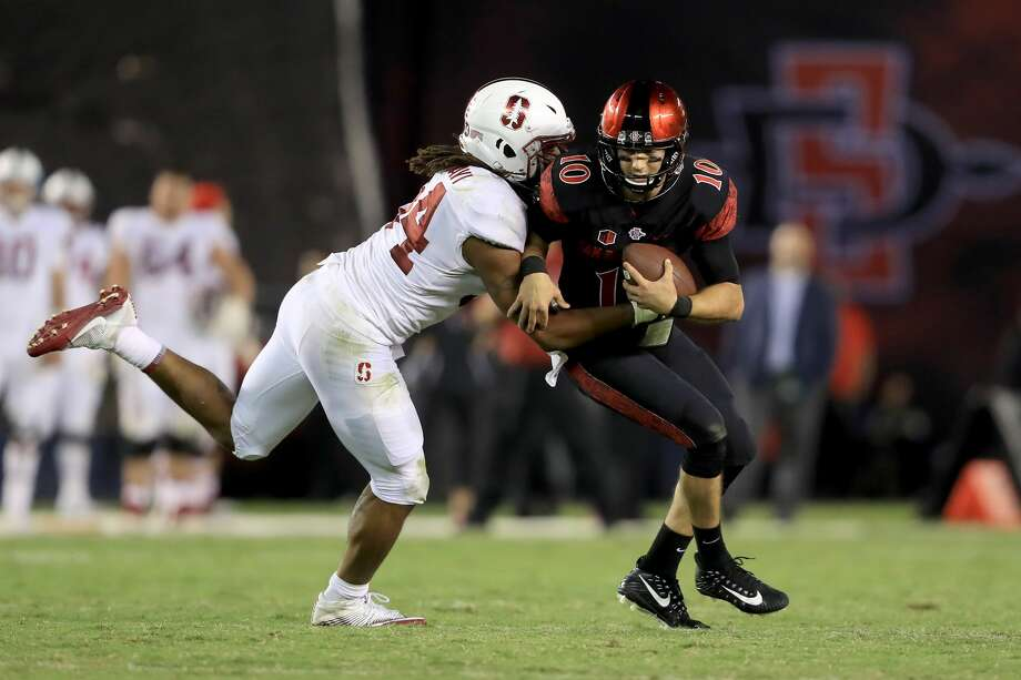SAN DIEGO, CA - SEPTEMBER 16:   Christian Chapman #10 of the San Diego State Aztecs is tackled by Peter Kalambayi #34 of the Stanford Cardinal during the second half of a game at Qualcomm Stadium on September 16, 2017 in San Diego, California.  (Photo by Sean M. Haffey/Getty Images) Photo: Sean M. Haffey/Getty Images