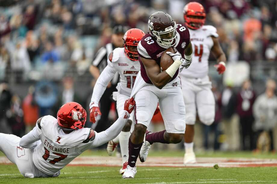 JACKSONVILLE, FL - DECEMBER 30: Mississippi State Bulldogs tight end Jordan Thomas (83) runs through the tackle attempt by University of Louisville Cardinals linebacker Dorian Etheridge (17) during the first half of the TaxSlayer Bowl game between the Louisville Cardinals and the Mississippi State Bulldogs on December 30, 2017, at Everbank Field in Jacksonville, FL. (Photo by Roy K. Miller/Icon Sportswire via Getty Images) Photo: Icon Sportswire/Icon Sportswire Via Getty Images
