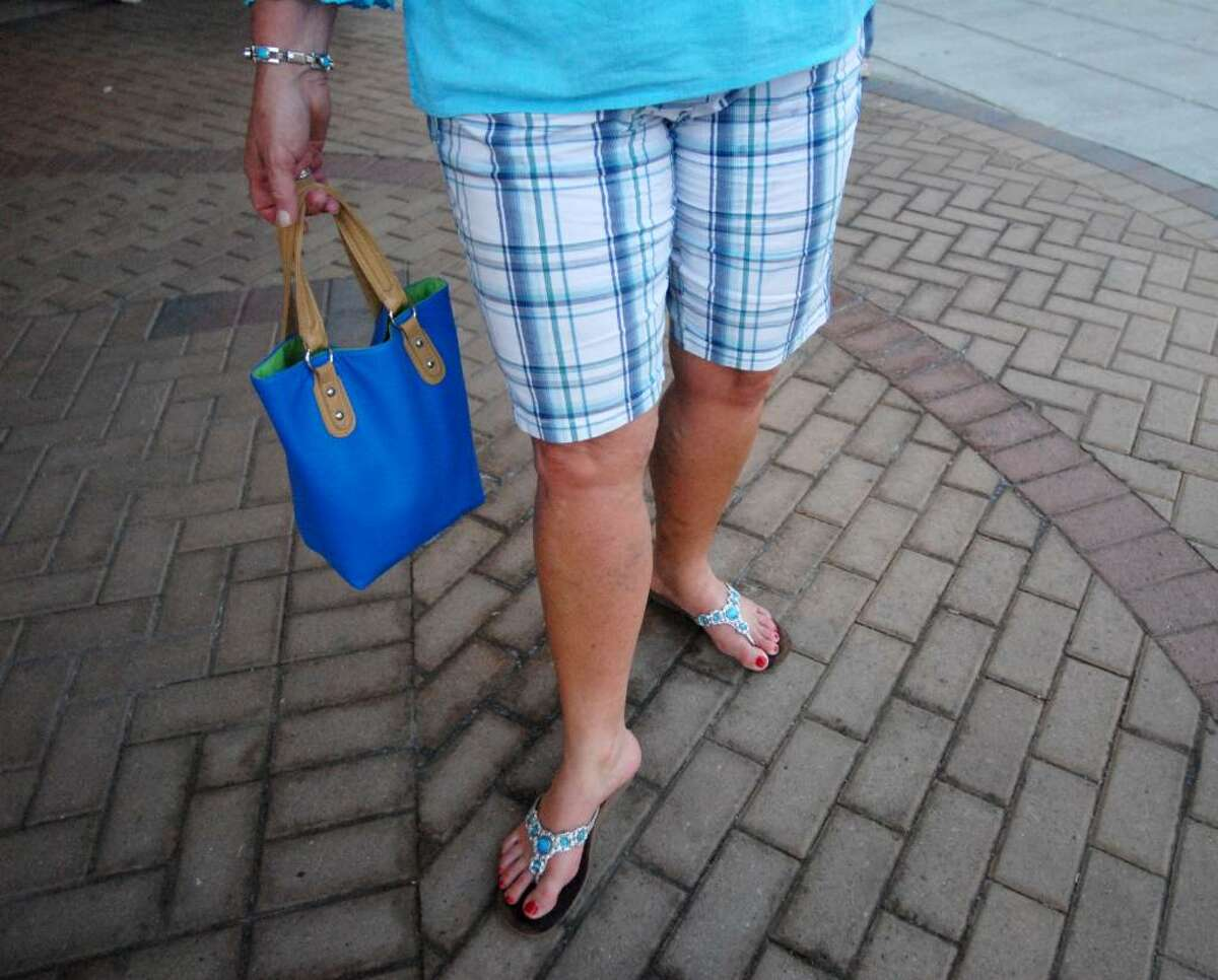 Kelly Suriano, 48, of Charlton, doesn?t mind showing off her legs in her colorful shorts from Cinema catalog. (Kayla Galway / Times Union)