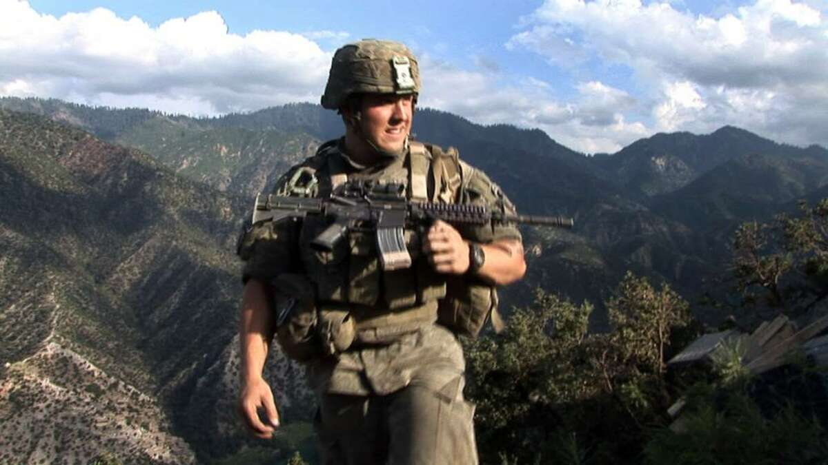 Specialist Kyle Steiner of Second Platoon, Battle Company, 173rd US Airborne at Outpost Restrepo. Korengal Valley, Afghanistan, Kunar Province. 2008. A film still from the documentary RESTREPO by Tim Hetherington and Sebastian Junger. Image ? Outpost Films