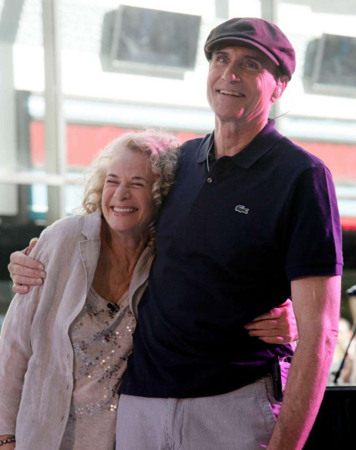 In this June 18, 2010, file photo, Carole King and James Taylor pose for photos during their appearance on the NBC