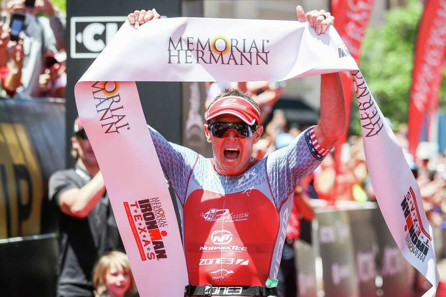 Matt Hanson, of Iowa, celebrates as he finishes in first place during the IRONMAN North American Championship on Saturday, April 28, 2018, in The Woodlands. (Michael Minasi / Houston Chronicle) Photo: Michael Minasi, Staff Photographer / © 2018 Houston Chronicle
