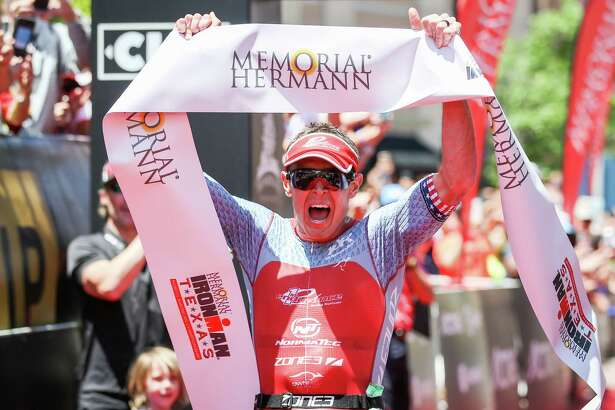 Matt Hanson, of Iowa, celebrates as he finishes in first place during the IRONMAN North American Championship on Saturday, April 28, 2018, in The Woodlands. (Michael Minasi / Houston Chronicle)