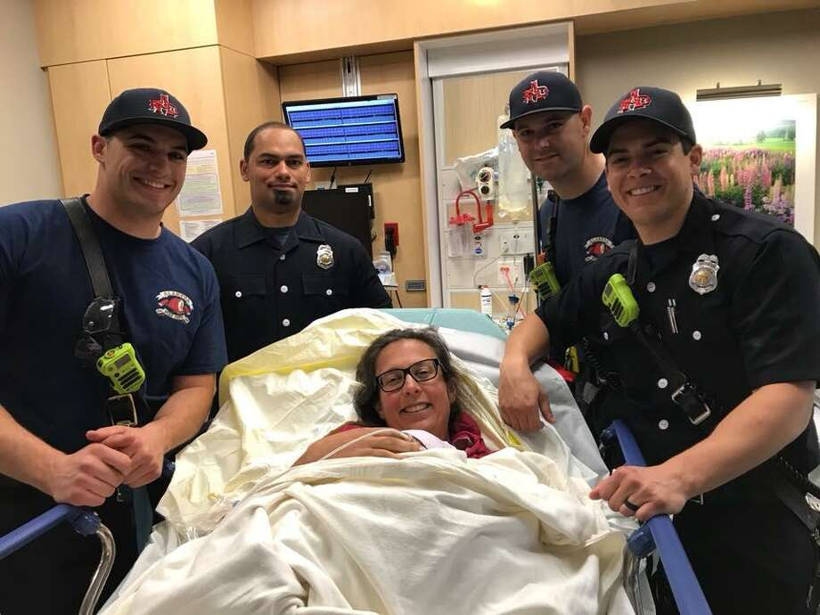 While transporting a woman in labor to a nearby hospital, Alameda firefighters helped deliver a healthy baby girl.