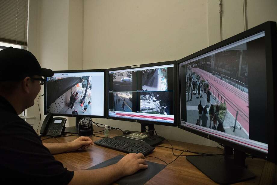 A staff member of the Union Square group retrieves screen captures from recorded footage of crimes. Photo: Paul Kuroda / Special To The Chronicle