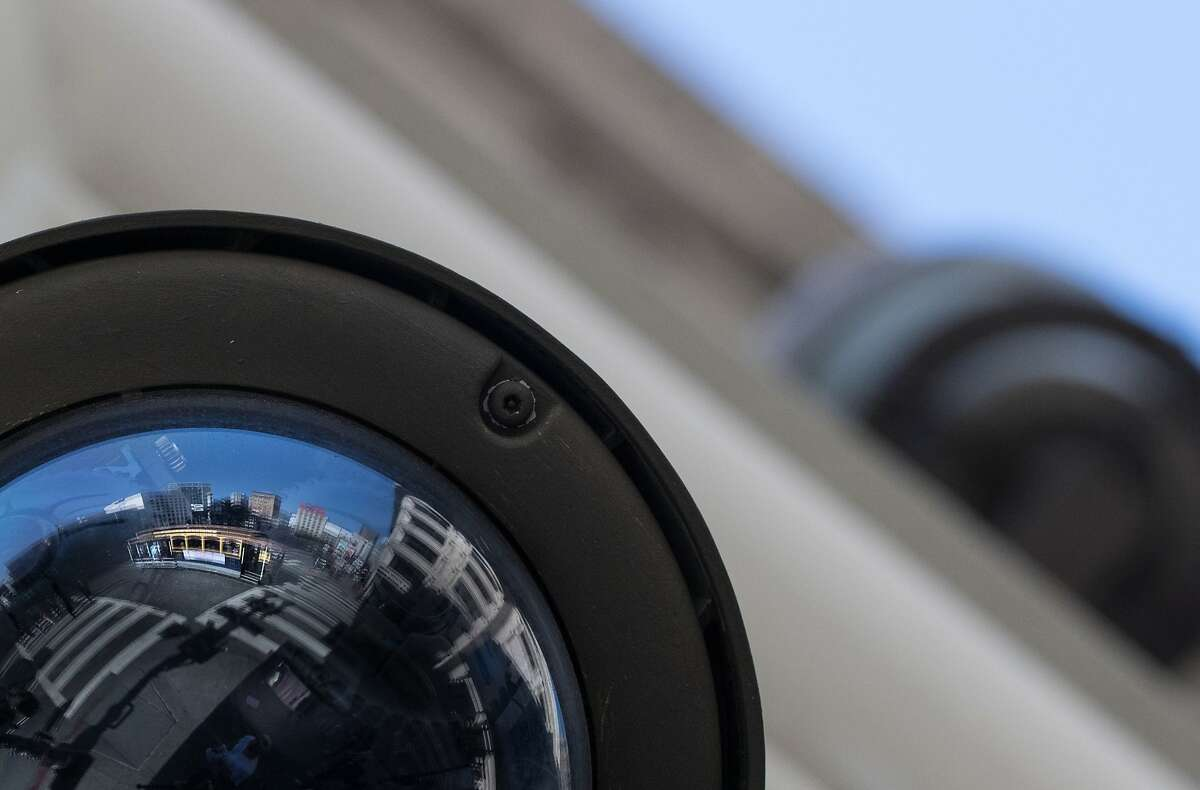 A cable car is reflected in a CCTV camera mounted along Powell Street in San Francisco.