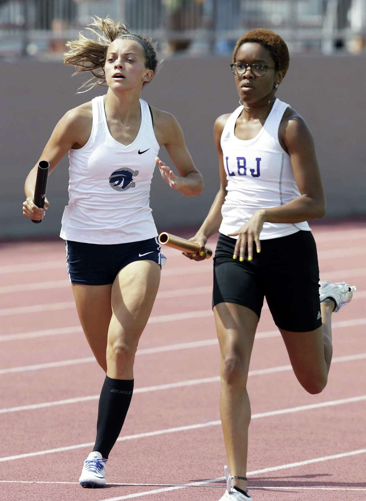 Layne Bolli of Boerne Champion overtakes to win the 4X400 for the Chargers during the Region IV-6A and Region IV-5-A track and filed meet at Alamo Stadium on April 28, 2018.