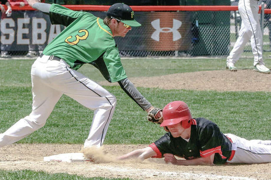 Southwestern first baseman Brock Seymour (left) puts a tag on pick-off play at first base while Calhoun's Jonny Laing dives in safely during one of three prep baseball games Saturday in Gillespie. Photo:       Nathan Woodside / For The Telegraph