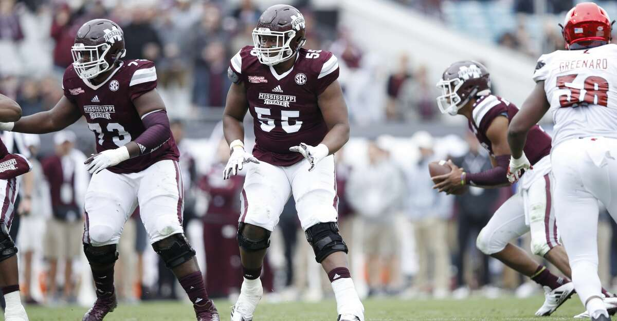 JACKSONVILLE, FL - DECEMBER 30: Martinas Rankin #55 of the Mississippi State Bulldogs blocks against the Louisville Cardinals during the TaxSlayer Bowl at EverBank Field on December 30, 2017 in Jacksonville, Florida. The Bulldogs won 31-27. (Photo by Joe Robbins/Getty Images)