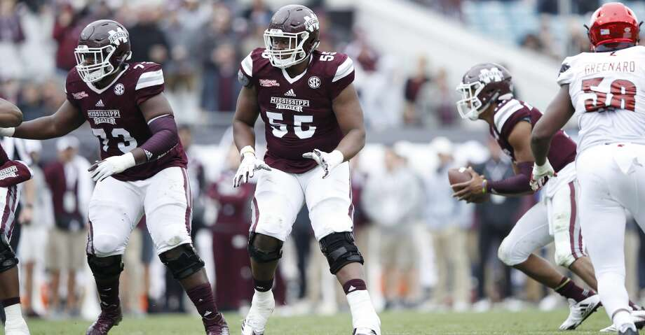 JACKSONVILLE, FL - DECEMBER 30: Martinas Rankin #55 of the Mississippi State Bulldogs blocks against the Louisville Cardinals during the TaxSlayer Bowl at EverBank Field on December 30, 2017 in Jacksonville, Florida. The Bulldogs won 31-27. (Photo by Joe Robbins/Getty Images) Photo: Joe Robbins/Getty Images