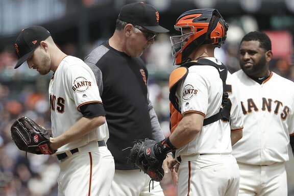 San Francisco Giants pitcher Chris Stratton, left, walks off the mound after being relieved by manager Bruce Bochy, center left, as catcher Nick Hundley, center right, and third baseman Pablo Sandoval watch during the second inning of a baseball game against the Los Angeles Dodgers in San Francisco, Saturday, April 28, 2018. (AP Photo/Jeff Chiu)