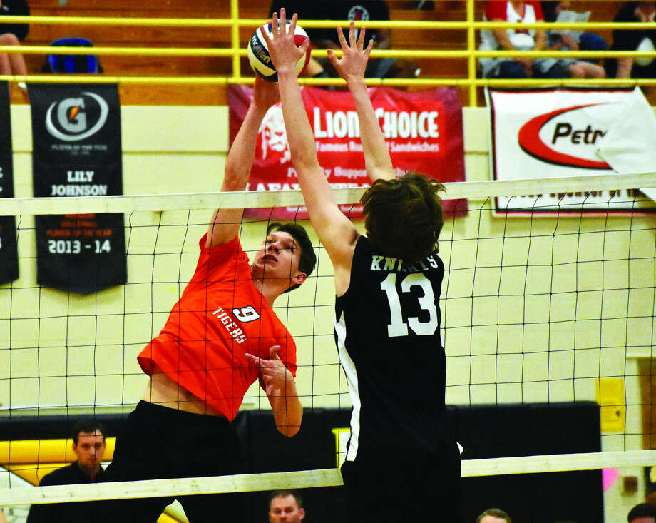 EHS outside hitter Bob Dresner, left, goes up for a kill attempt during a match against Francis Howell North at the Lafayette Invitational.