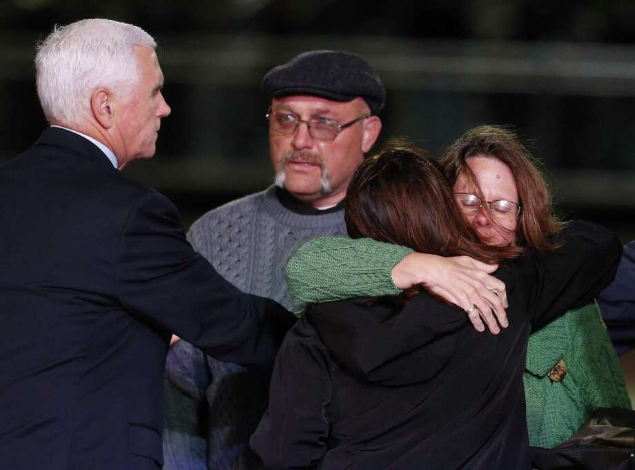 Sherri Pomeroy, center, receives a hug from Second Lady Karen Pence as Vice President Mike Pence, left, talks with Frank Pomeroy, background center, at Floresville High School on Nov. 8, 2017. The Pences were paying respects to the victims of the mass shooting at the First Baptist Church of Sutherland Springs. Photo: Kin Man Hui /San Antonio Express-News / ©2017 San Antonio Express-News