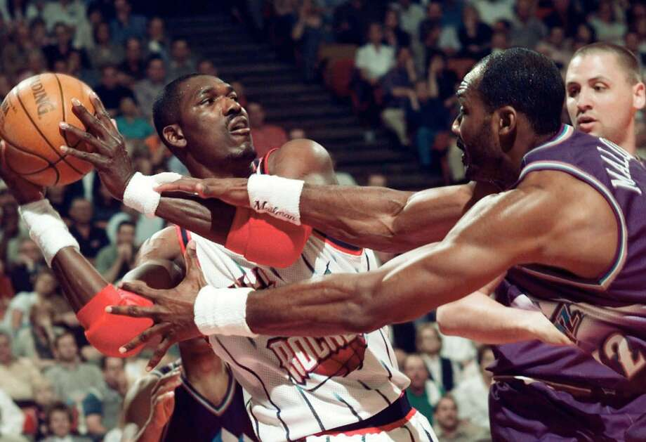 Hakeem Olajuwon and Karl Malone battled each other in four playoff series in a five-season span from 1994 to 1998 as the Rockets and Jazz became fierce rivals. Photo: DAVID J. PHILLIP, AP / AP