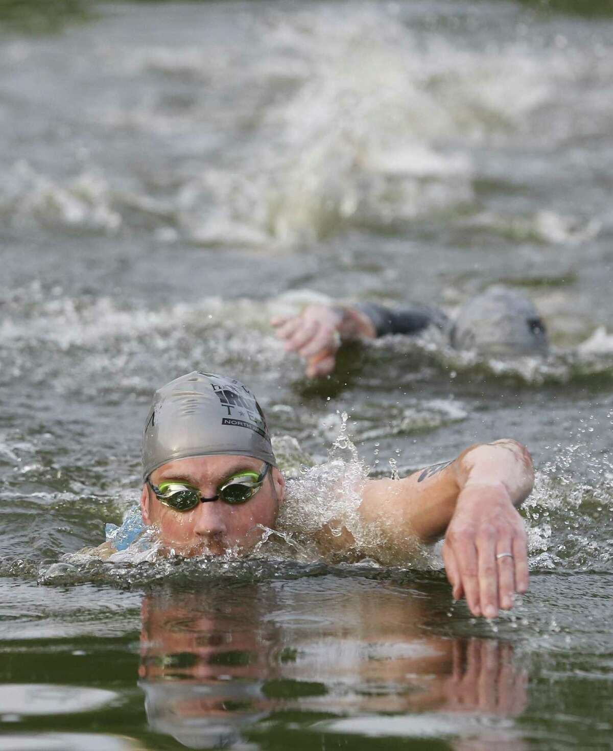 Professional athlete Sean Donnelly swims in as first in the swimming part at the 2018 Memorial Hermann IRONMAN® North American Championship Texas Triathlon on Saturday, April 28, 2018, in The Woodlands. The IRONMAN features 2.4 miles of swimming, 112 miles of biking and 26.2 miles of running. ( Yi-Chin Lee / Houston Chronicle )