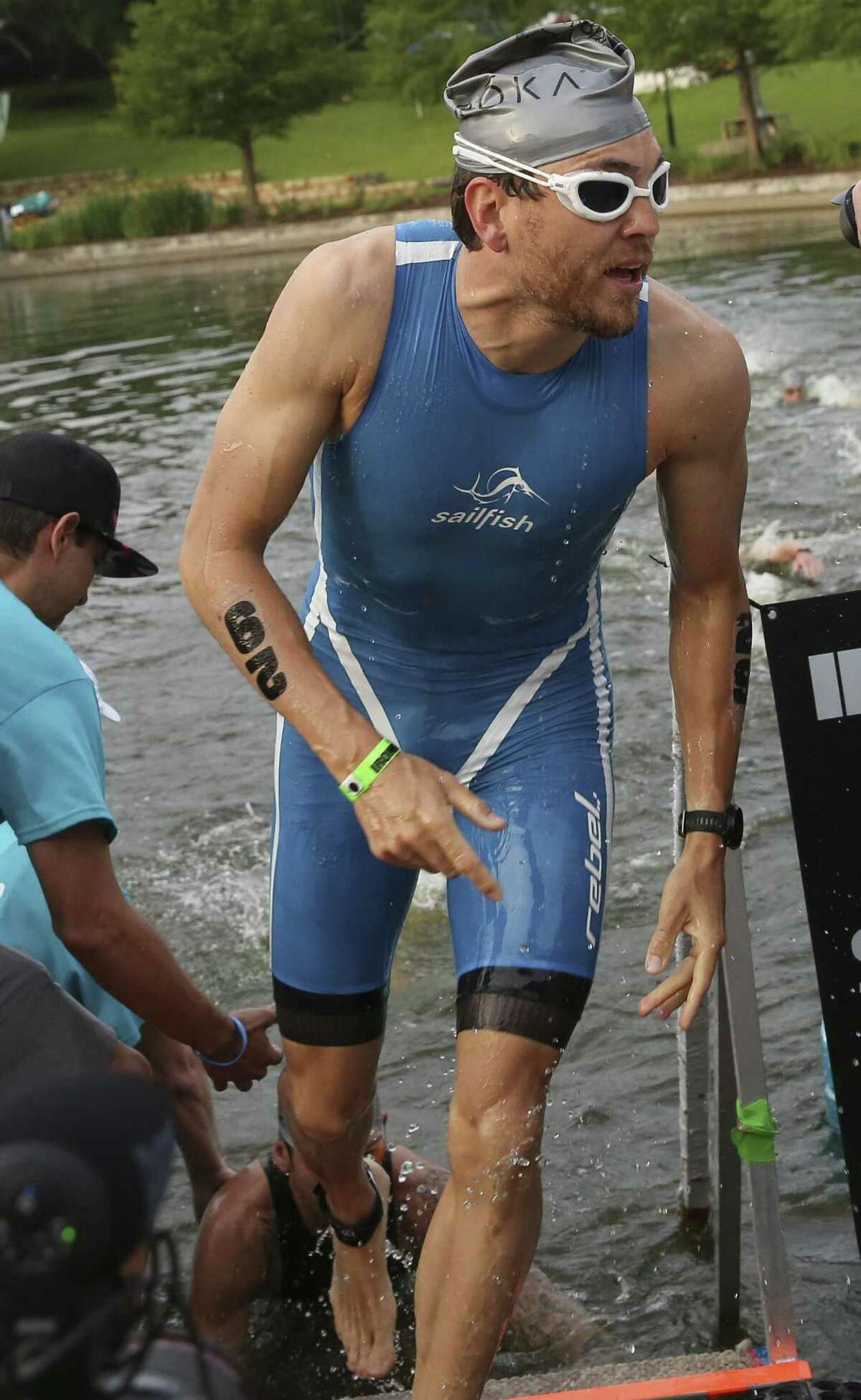 Professional athlete Johann Ackermann comes out of the water while competing in the 2018 Memorial Hermann IRONMAN® North American Championship Texas Triathlon on Saturday, April 28, 2018, in The Woodlands. The IRONMAN features 2.4 miles of swimming, 112 miles of biking and 26.2 miles of running. ( Yi-Chin Lee / Houston Chronicle )