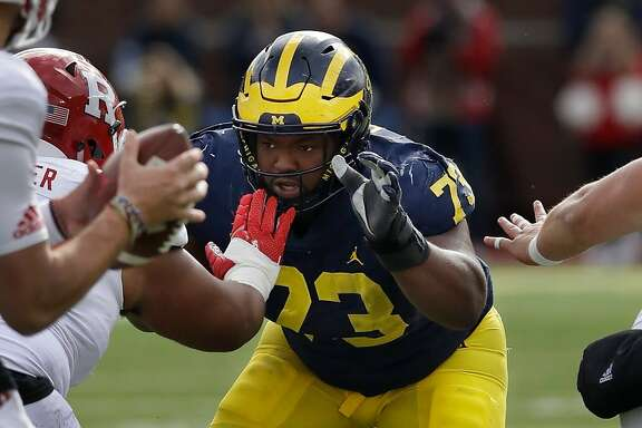 FILE - In this Oct. 28, 2017 file photo Michigan defensive lineman Maurice Hurst (73) goes up against the Rutgers line during the first half of an NCAA college football game in Ann Arbor, Mich. The Oakland Raiders traded up in the fifth round on Saturday, April 28, 2018 to take Hurst, who fell from a projected first-round pick to off some draft boards due to concerns from a heart condition that got him sent home from the combine. (AP Photo/Carlos Osorio, file)