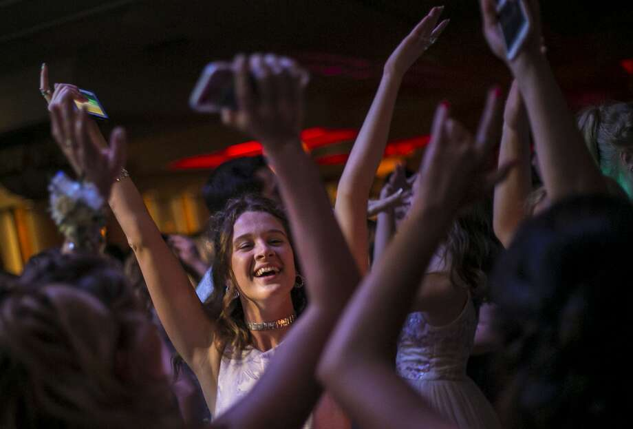 Dow High School student Quinn McCaffrey, 18, dances with friends at the Midland and Dow High School prom held at Great Hall Banquet and Conference Center in Midland on Saturday, April 28, 2018. (Josie Norris/for the Daily News) Photo: Josie Norris/Midland Daily News