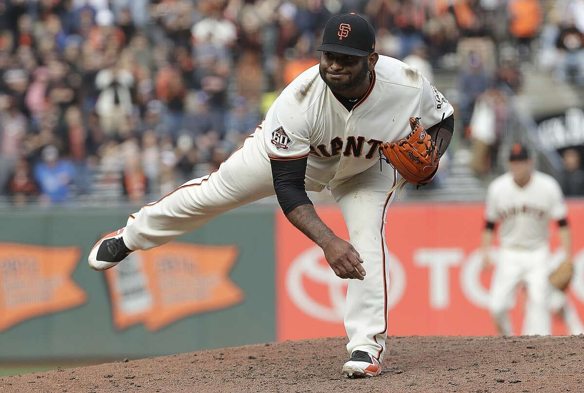 San Francisco Giants' Pablo Sandoval pitches against the Los Angeles Dodgers during the ninth inning.