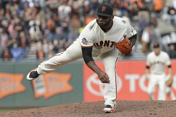 San Francisco Giants' Pablo Sandoval pitches against the Los Angeles Dodgers during the ninth inning of a baseball game in San Francisco, Saturday, April 28, 2018. (AP Photo/Jeff Chiu)