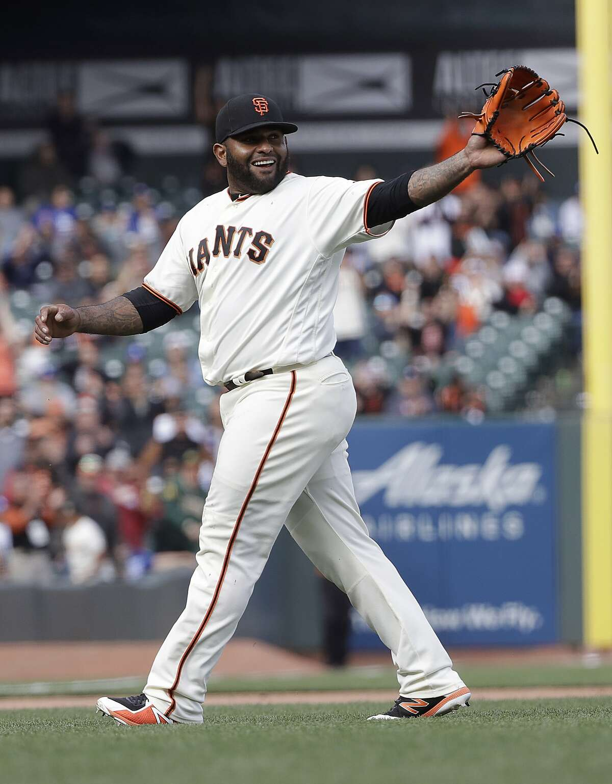 San Francisco Giants' Pablo Sandoval smiles after pitching against the Los Angeles Dodgers during the ninth inning of a baseball game in San Francisco, Saturday, April 28, 2018.