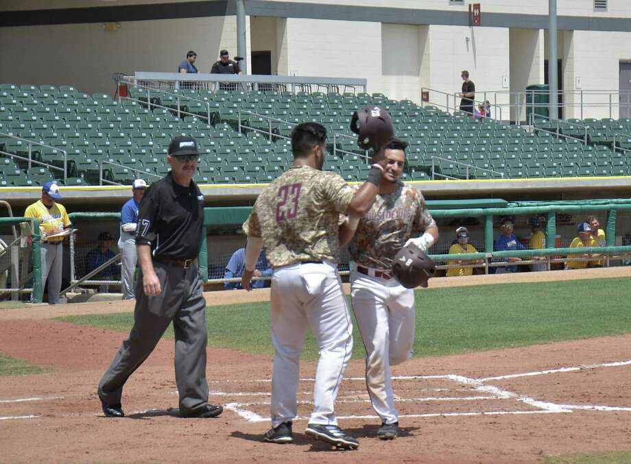 Left fielder Alex Cabezas, right, was 2-for-3 with a two-run homer during Game 1 of the Dustdevils' doubleheader at Uni-Trade Stadium Saturday losing 8-4 and 7-1 to St. Mary's. TAMIU has now lost 15 straight games with four to play, one shy of the school's record losing streak from 2009. Photo: Christian Alejandro Ocampo /Laredo Morning Times / Laredo Morning Times