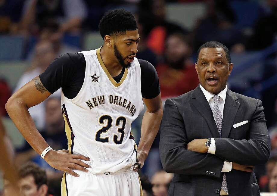 """FILE - In this Jan. 18, 2017, file photo, New Orleans Pelicans forward Anthony Davis (23) talks with head coach Alvin Gentry in the second half of an NBA basketball game against the Orlando Magic in New Orleans. Golden State Warriors head coach Steve Kerr refers to Pelicans star Davis """"one of the very best players on earth."""" Kerr knew he wanted Gentry on Golden State's staff when hired to coach the Warriors before the 2014-15 season and it was among the first calls he made. (AP Photo/Max Becherer, File) Photo: Max Becherer / Associated Press"""