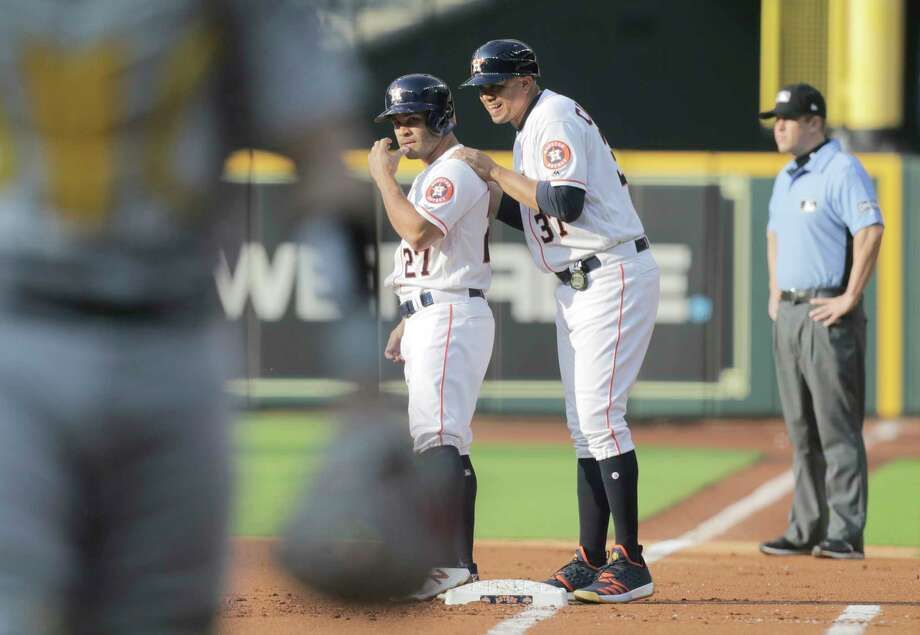 Houston Astros first base coach Alex Cintron (37) chats with Houston Astros second baseman Jose Altuve (27) after he made it to first in the first inning against the Oakland Athletics at Minute Maid Park on Saturday, April 28, 2018, in Houston. Astros are behind in the series 1-0. Photo: Elizabeth Conley, Houston Chronicle / © 2018 Houston Chronicle