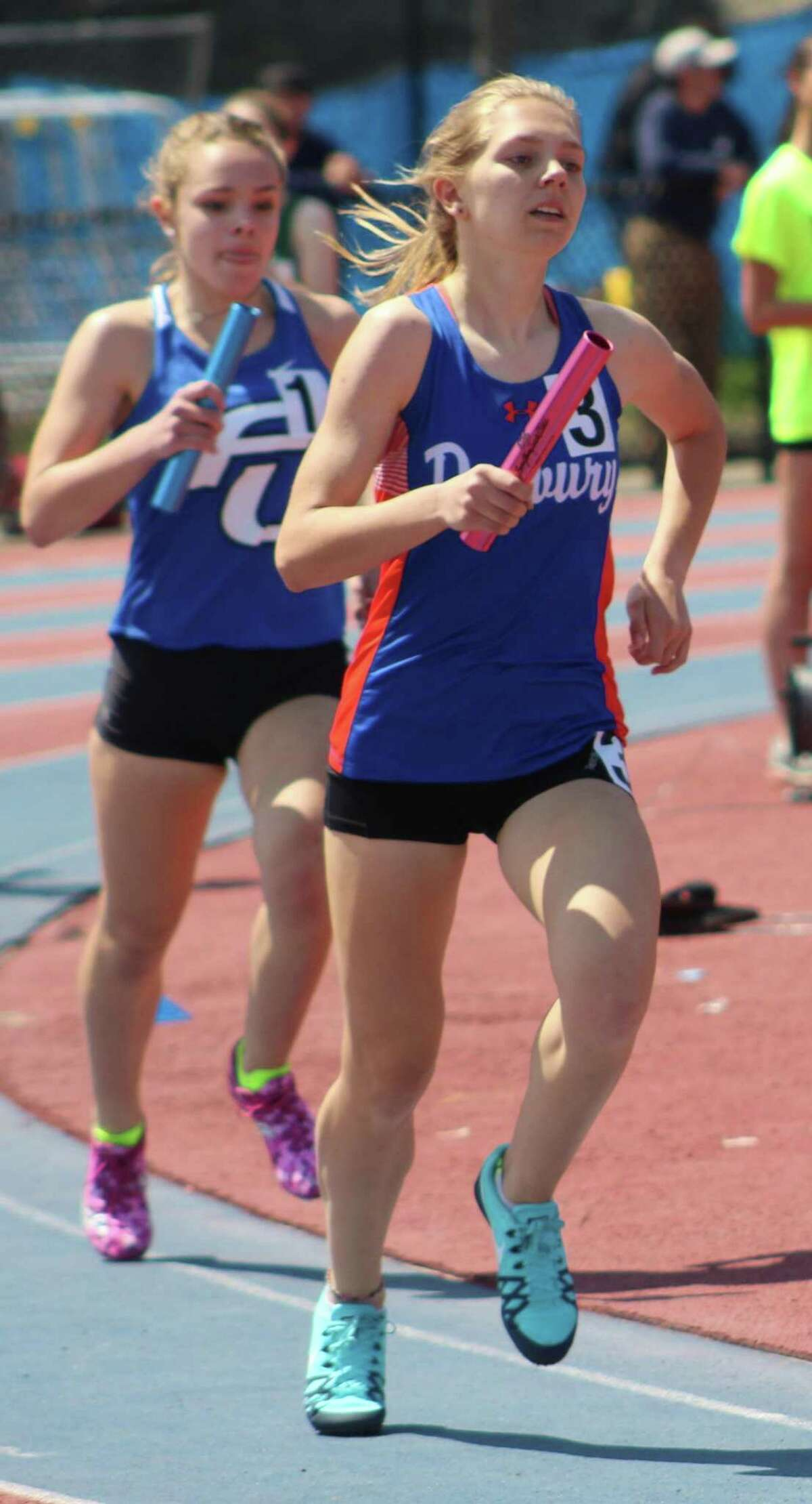 Danbury's Leah Sarkisian competes in the girls 4x800 relay at the O'Grady Relays at Danbury High School April 28, 2018.
