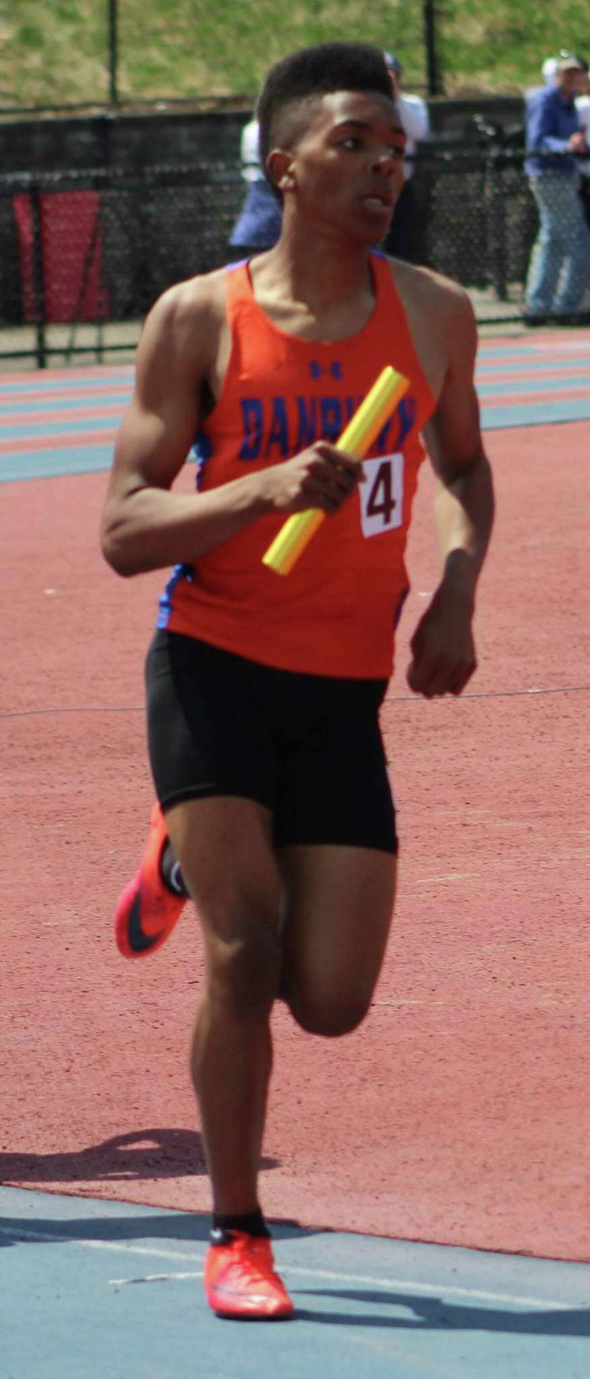 Danbury's Glenroy Ford competes in the boys 4x800 relay at the O'Grady Relays at Danbury High School April 28, 2018.